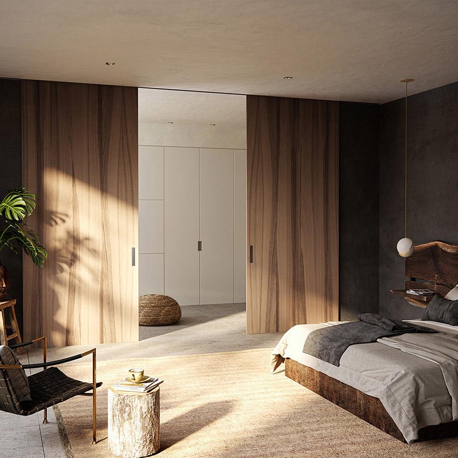 Puerta corredera de interior en madera que separa dormitorio y vestidor - Ferrero Legno